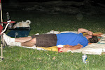 Chad passes out on the blanket after a long day