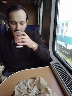 My brother enjoying his breakfast on the train to Udine