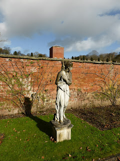 A Statue In The Walled Garden