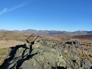 Looking towards the Scafell range and Harter Fell from a rocky knoll near Stainton Pike