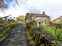 The last houses before the open countryside and Steel Fell