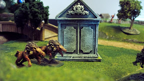 Dire Wolves lope around a crypt, far from the action