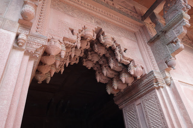 Intricate patterns carved into the red sandstone.