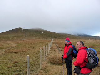 Admiring the scenery. Skiddaw Lesser Man and Skiddaw Little Man are just about in view.