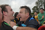 Clontibrets goal keeper Paul McElroy in a happy mood with his manager Declan Brennan after saving a penalty kick from Tommy Freeman to give Clontibret the Championship.  Pic Philip Fitzpatrick