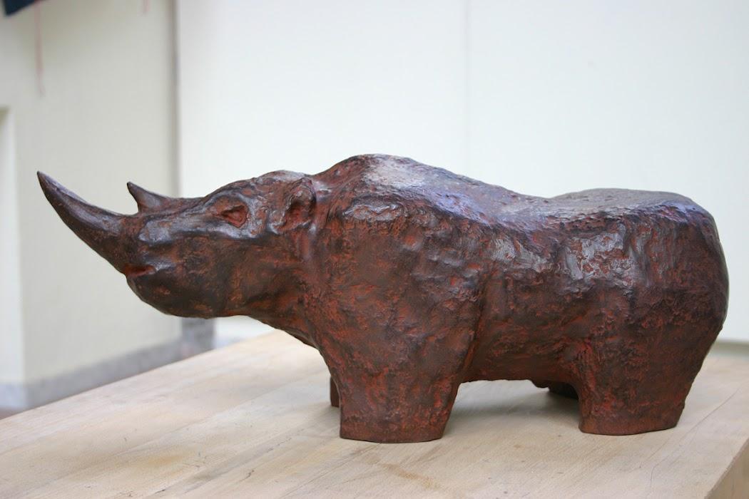rhinoceros (sculpture by frank waaldijk, left)