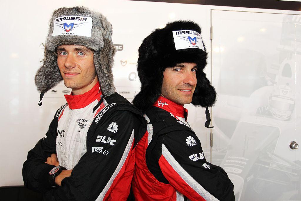 Шарль Пик и Тимо Глок в шапках-ушанках на Гран-при Испании 2012