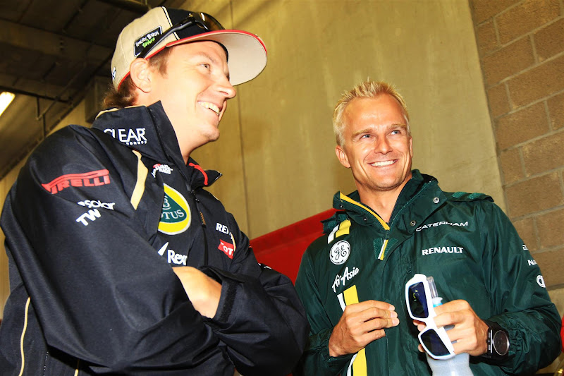улыбающиеся Кими Райкконен и Хейкки Ковалайнен на Гран-при Бельгии 2012