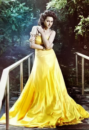 Sonakshi Sinha Cute Photoshoot In Yellow Color Gown Dress and Curly With Bun Hairstyles