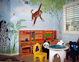 Muhammad Playroom 1 of 2 - A play kitchen and game table with animal chairs create a wonderful space for creative play and complement the jungle look.