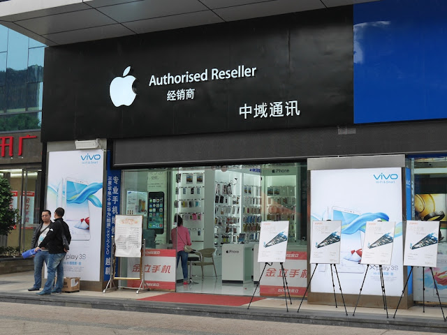 Vivo signs at an Apple authorized retail store in Hengyang, Hunan