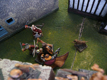 A necromancer, fallen from a a northwest wall, gets a rude reception by Captain Anton of the Kislevites and two of his henchmen.  Sister Anne and Brother Woof hover nearby.