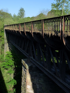 The viaduct for the Monsal Trail spans over the main road far below