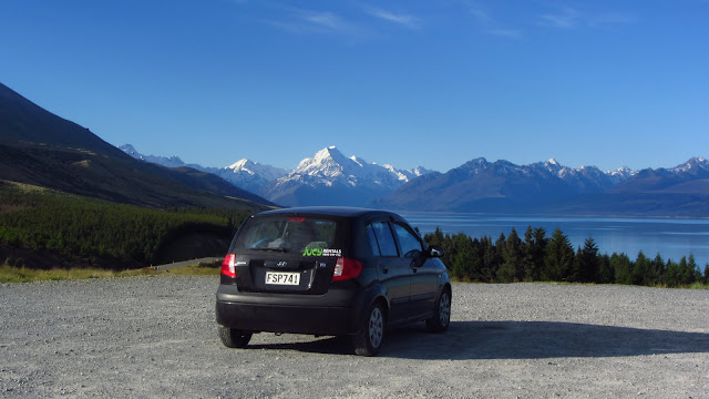 Our trusty little Jucy rental car and New Zealand's Southern Alps.