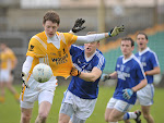 Clontibrets Conor McManus fights hard to get away from Naomh Conalls Tommy Donoghue in the Ulster Club Football Quarter final game at Ballybofey.  Pic Philip Fitzpatrick