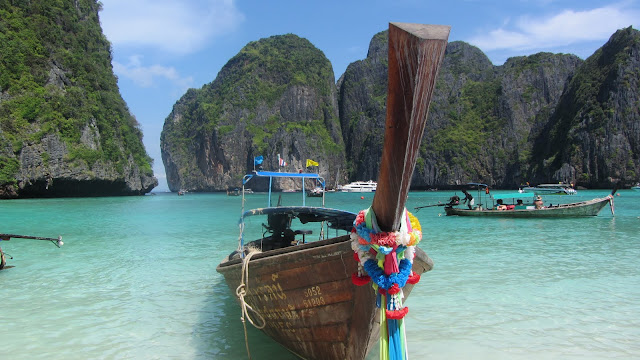 A longtail boat against the beautiful backdrop of Maya Bay.