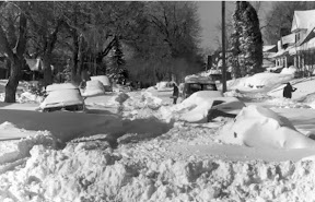 Cars are buried under the heavy snow in Denver.  Scroll down for a photo slideshow with more images. (Denver Public Library Digital Collection)