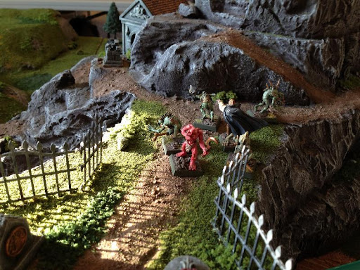 A Vampire and Ghouls guard the hilltop cemetery