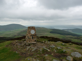 Gowbarrow Fell Summit with Ullswater in the distance.