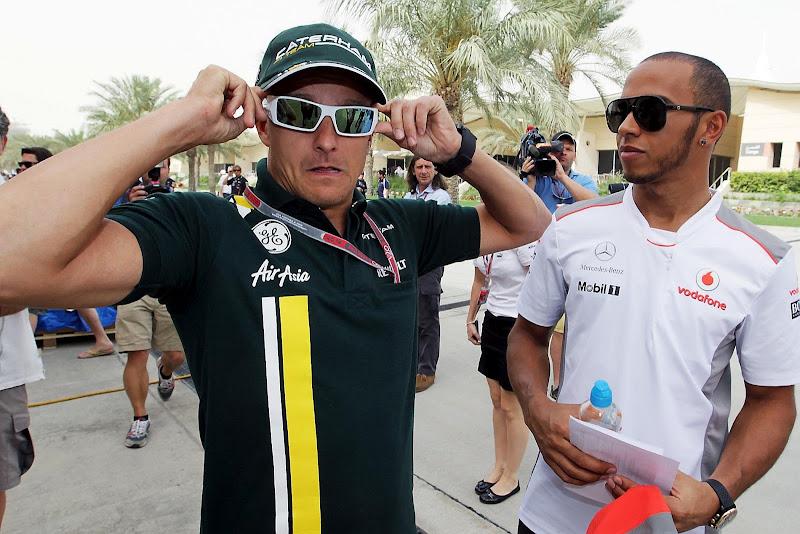 Хейкки Ковалайнен и Льюис Хэмилтон в очках на Гран-при Бахрейна 2012