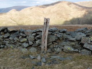 The true summit of Hartsop Dodd is marked by an old woodden post.