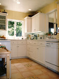 Haberfelde Kitchen - This extensive remodeling project created a very functional kitchen, while keeping the charm of the older home including the use of hand-painted tiles and an old-fashioned faucet.