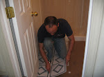 Me hard at work tiling the floor