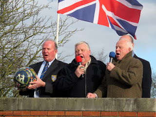 Mick Pepper sings the National Antham before the start of the game