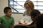 In our language immersion programs, read-alouds also happen in the target language. Here, children are being read to out of a Chinese picture books.