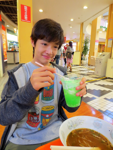 Kai is not sure sure about his melon soda and vanilla ice cream float