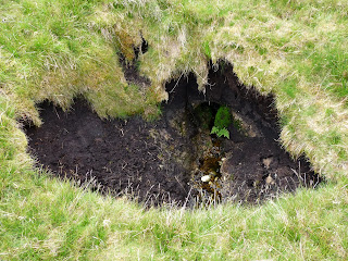 A boggy hole on the descent from Rannderside - somewhere as we meandered across Dowthwaitehead Moss.