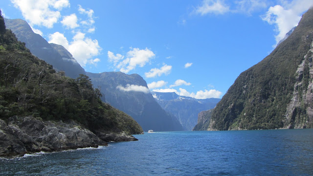 Steep mountains and waterfalls frame Milford Sound.
