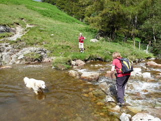 Easy does it ... as Ann crosses Mosedale Beck stepping stones