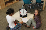 Learning to tell time is much more enjoyable when it's a game, something you do together with a friend, comfortably, on the floor--rather than completing worksheets at desks.