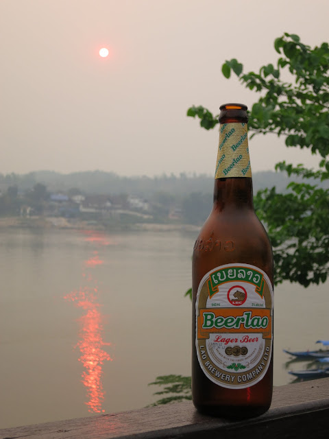 Our first delicious Beerlao beer, overlooking a hazy sunset.