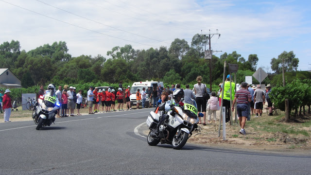 A police motorcade following the pack leaders for the Tour Down Under.