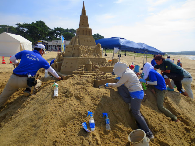 A sand castle under construction, for the sand castle competition at Shingu beach
