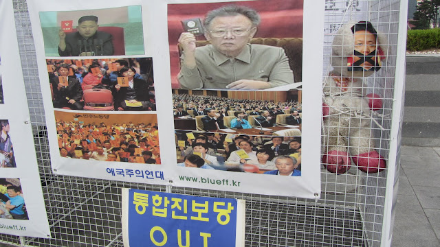 Like father, like Un? Anti Kim Jong-un displays in Seoul.