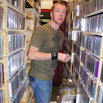 Aden was blissfully lost in the rare CD store at the front of the ballroom