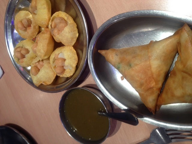 Samosas and gol guppa (chickpeas in rice flour balls) with tamarind sauce