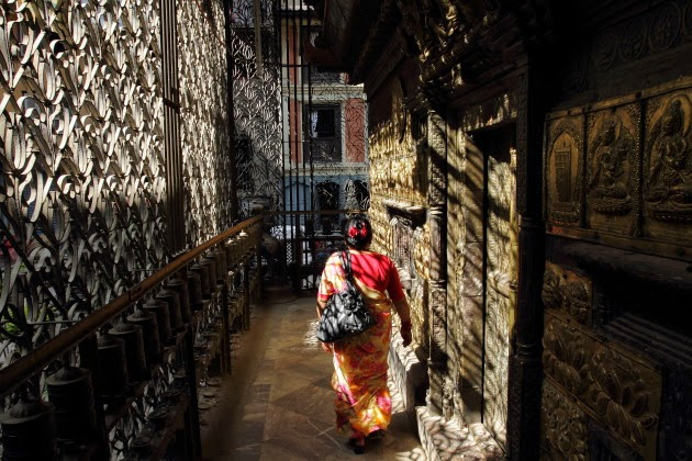 Nepali lady offering her prayers at a Hindu Buddhist temple in Kathmandu