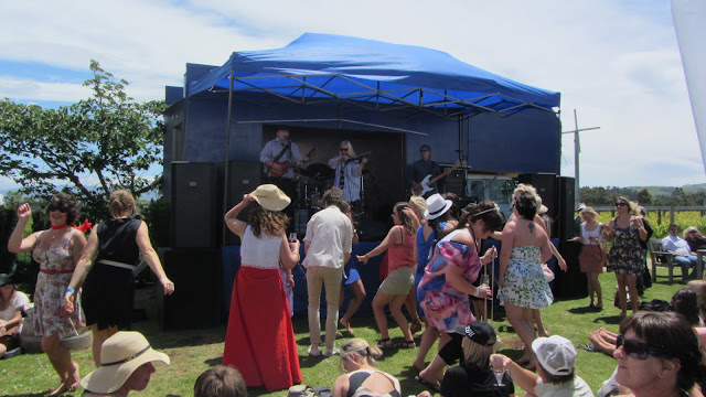 Revelers enjoying the music from one of the live bands.