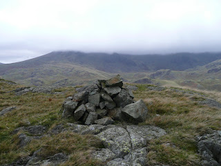 Cairn on descent from Hard Knott - Scafells well in the cloud