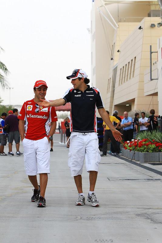Фелипе Масса и Бруно Сенна идут по паддоку Гран-при Бахрейна 2012