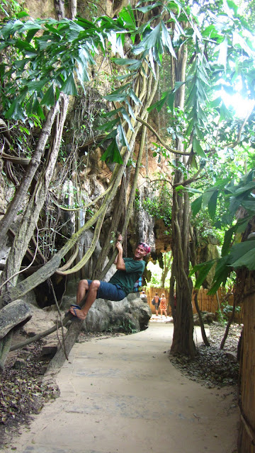 Erik hanging off a vine near one of the footpaths that connect West and East Railay.