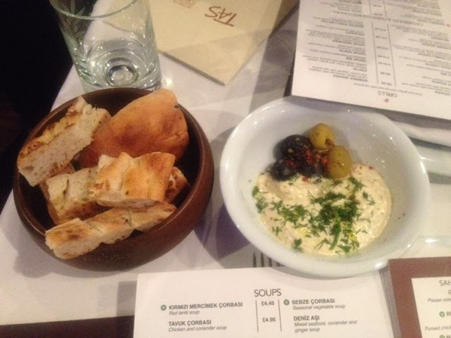 Complimentary hummus and bread served at tas restaurant, London