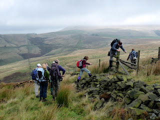 Negotiating a stile on Burbage Edge