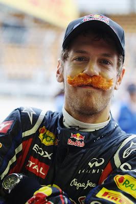 Себастьян Феттель с усами после рекордного 16-го поула на Гран-при Бразилии 2011