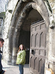 Susan stands at the gate to the Salisbury cloister