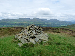 Top O'Selside summit cairn looking to the Coniston Fells.